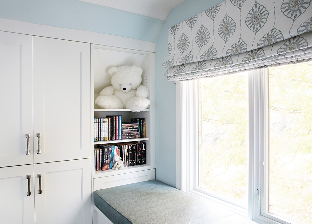Children bedroom window seat with roman shades, teal seafood with white cabinets